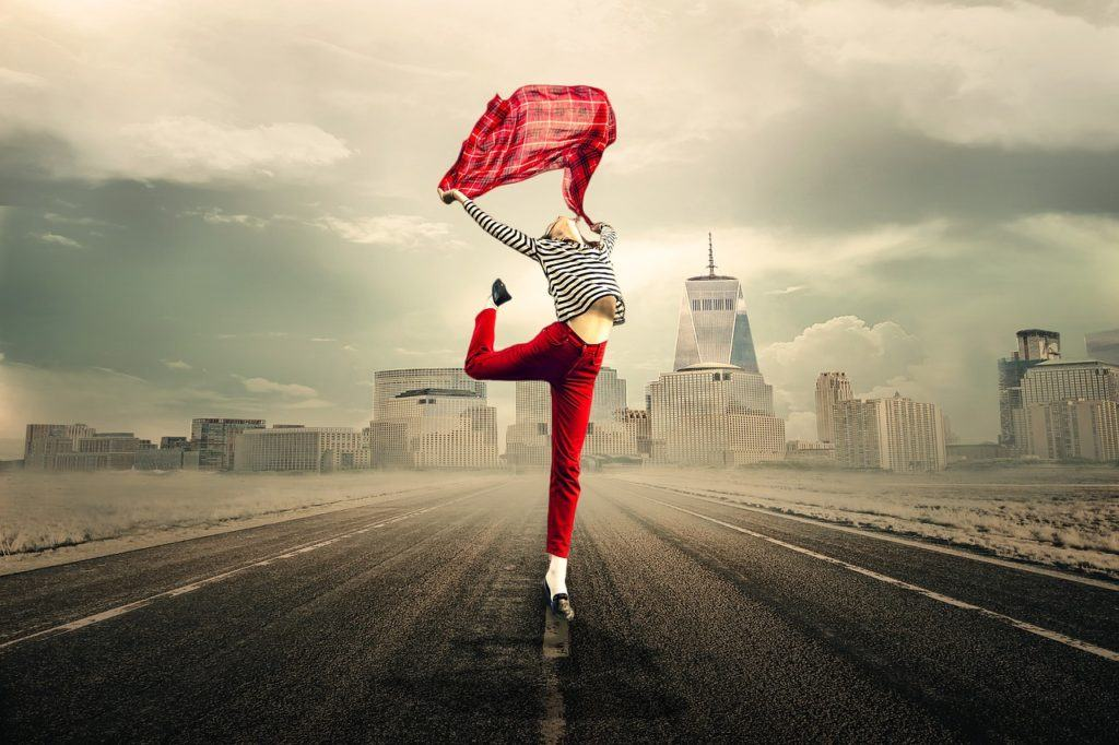 woman dancing with a red cloth on the street