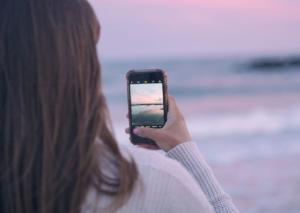 girl taking photo on mobile phone