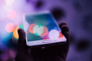 Mobile in a hand depicting digital marketing